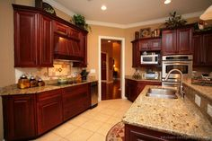 Traditional Dark Wood-Cherry Kitchen Cabinets #48 (Kitchen-Design-Ideas.org)     WITH the khaki tan painted walls