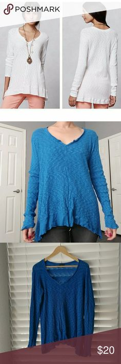 """Anthropologie Left of Center notched V-neck blue S Notched v neck Henley like top by Anthropologie brand Left of Center. Color is bright blue, stock photo to show fit.  The material is a bit thicker so it's almost like a sweater. Rayon with touch of spandex. Oversized, slouchy fit with lots of room to layer. Slight hi-lo hem. 27"""" length. Anthropologie Sweaters V-Necks"""