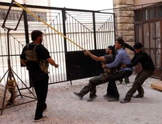 Free Syrian Army fighters launch a home-made bomb using a catapult during clashes in Aleppo on October 20, 2012. (Zain Karam/Reuters)