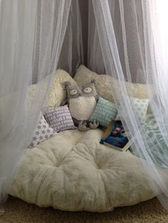 Cozy reading area. Love this. Already have a toile teepee to use!