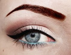 Classic natural pinup eye makeup with blue lined waterline