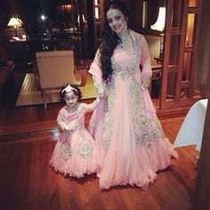 Kamaali Couture - How adorable is this bride with her Niece in matching ensembles from Kamaali couture# bridal finery# engagement# weddings# royal Mom Daughter Matching Dresses, Mom And Baby Dresses, Baby Girl Party Dresses, Birthday Dresses, Little Girl Dresses, Girls Dresses, Flower Girl Dresses, Red Lehenga, Lehenga Choli