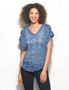 Talk about the perfect warm-weather sweater; this one can be worn with just about anything. Bonus: it's super lightweight, which means its perfect for cool summer nights. Open stitch pattern. Domestic.
