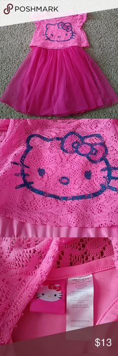 Cutest Hello Kitty Dress I absolutely loved this dress on my daughter.... But she grew, so now it's someone else's turn to enjoy it. She wore it with pink cowboy boots. Hello Kitty Dresses