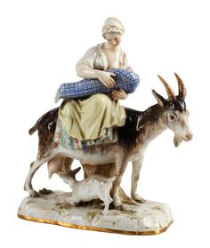 A Meissen figure of a woman and goat, late 19th century