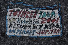 http://en.wikipedia.org/wiki/Toynbee_tiles