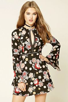 A woven dress featuring an allover floral print, ladder cutouts throughout, a round neckline, front cutout, long bell sleeves, buttoned keyhole back, a flared skirt, and a concealed back zipper.