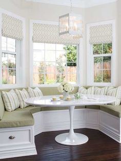 Amazing white dining nook is filled with a white tufted curved banquette, horseshoe shaped banquette, doubling as a window seat facing a round white dining table illuminated by an orb chandelier. Small Breakfast Nooks, Breakfast Nook Bench, Kitchen Breakfast Nooks, Breakfast Knook, Breakfast Room Ideas, Breakfast Nook Curtains, Banquette Seating In Kitchen, Kitchen Benches, Dining Nook