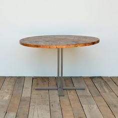 Pedestal dining table in reclaimed wood and steel legs in your choice of color, size and finish