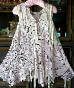 sew different pieces of lace together to make a vest or jacket - great idea