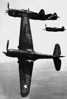 Squad of P40 Hawk diving to attack  WWII aircrafts