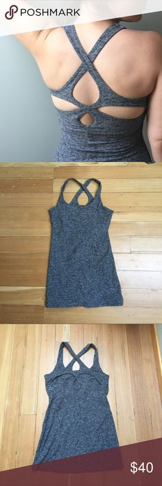 Beyond Yoga Grey Cutout Super Soft Yoga Tank Top I absolutely love this tank, but it doesn't fit my chest properly. It's a size Medium and has only been worn 3x so it looks and feels brand new. The material is super soft and stretchy, yet the top holds its shape and stays down while you're doing yoga. The bra is an unpadded shelf bra. Beyond Yoga Tops Tank Tops
