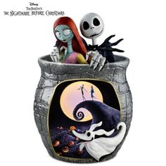 Cookie jar boasts authorized movie artwork, sculpted busts of Jack Skellington and Sally, raised-relief sculpt of Zero. Hand-applied 22K gold accents.