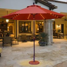 The Galtech 9ft lighted patio umbrella with crank lift provides shade during the day and LED lighting at night!