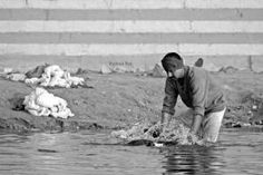 "Washer man cleaning dirty clothes at Ganges ""Reason why Ganges is getting polluted"""