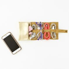 Charging cables, head phones, auxiliary cords + more will fit in this simple cord + plug roll-up.