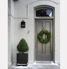 exterior paint colors  gray painted brick  gray door  love the black planter