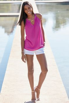 Add a pop of pink to your summer fashion arsenal with this little sleeveless number. Pairs perfectly with white shorts and sandals for a chic boardwalk-to-bistro look.