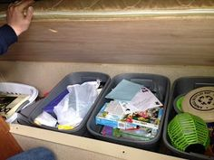 containers of storage for under the bench seating