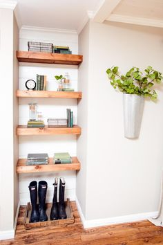 For an more contemporary look, Chip and Joanna Gaines paired painted shiplap siding with thick, streamlined wood shelves in this built-in shelving unit.