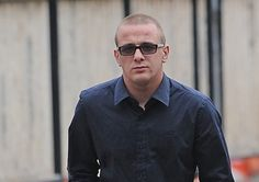 A drunken thug whose punch left a new dad in a coma for two weeks as he celebrated wetting his baby's head has been jailed for 14 months.