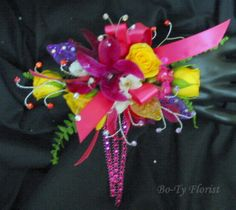 Wrist corsage - bold colorful mix of flowers.
