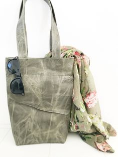 Cool green grey firm leather shopper bag.