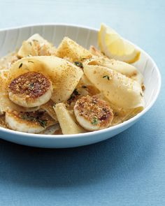 Seared fresh scallops pair beautifully with garlicky pasta. If you like, you can substitute 12 ounces of egg fettuccine for the pappardelle. Slicing the raw scallops in half horizontally will give you more pieces and more delicious seared crust.