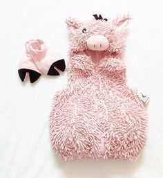 Made by Authentic Kids. One piece zip up pink pig costume with open face and pig head as the hood. Small black bow on top. Coverings for the hands to look like