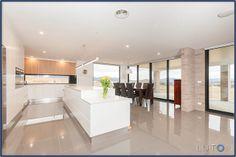 "My house  - Open Kitchen and Meals Area Caesarstone ""White Shimmer"" Cabinets Dulux ""White on white"" PU, Laminex ""waxed Oak"" Splash Black glass"