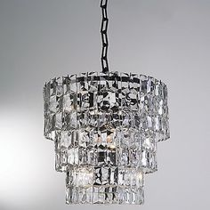 The Prism Chandelier by Global Views showcases the refractive splendor of its namesake with 46 individual pieces of faceted glass that hang from a 3-tiered Bronze frame.
