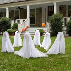 Ghostly Group Lawn Set - This is an easy DIY (plastic lawn stakes covered with white waterproof sheeting, decorate faces, & place in a circle, connecting ghost tails together)  Target sells three 3 foot ghost as shown for $25.00...I can make this. Yes I can!