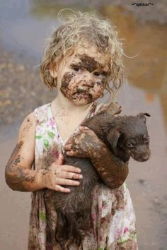 covered in mud & carrying a puppy!