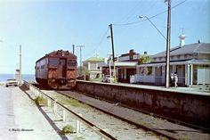 Possibly at the former terminus station, on the long - abandoned Semaphore Line, a 400 Class Red Hen train awaits departure for the Outer Harbor line interchange station of Glanville, in Adelaide's mid northwest suburbs. South Australia, Western Australia, Bnsf Railway, Red Hen, Train Journey, Tasmania, Buses, North West, Old Photos
