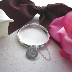 Newborn Baby Bangle Sterling Silver with Personalized Engraved Name Disc New Baby Gift Baby Keepsake Bracelet by FairyTaleJewelsLLC on Etsy https://www.etsy.com/listing/183240901/newborn-baby-bangle-sterling-silver-with
