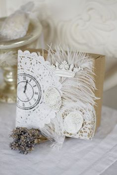 Love this decorated bag with doily clock and feather in white