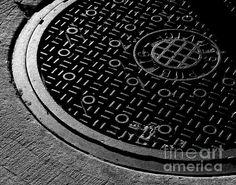 Public Service Manhole - photograph by James Aiken. Fine art prints for sale. #jamesaiken #blackandwhitephotography #lightandshadow