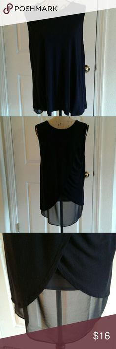 Tulip back sleeveless top Body is 100% rayon, back under layer 100% polyester. Shoulder to bottom hem in front is 28 inches. No pilling,  holes or snags. Size is xxl,  it's a perfect 2x fit Ellen Tracy Tops