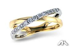 White gold and yellow gold diamond crisscross ring.