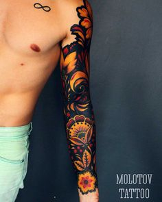 Super cool Russian Ornament sleeve tattoo. It definitely reminds me of the art work on a nesting doll. Love the bold black lines. Really strong piece. #CuratedTattoos