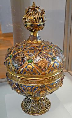 Ciborium of Maître Alpais Limoges,gilded copper with champleve enameld,glass cabochons,ca 1200.