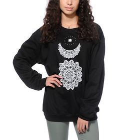 Crafted with a soft and thick fleece construction for comfort, this black crew neck sweatshirt features a tribal style sun, moon and star graphic printed on the front.