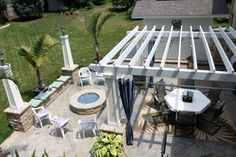 """Not white pergola. Ian """"needs"""" a glass fire pit. Outdoor Spaces, Outdoor Living, Outdoor Decor, Glass Fire Pit, White Pergola, Photo Library, Outdoor Activities, Palm Trees, Outdoor Furniture Sets"""