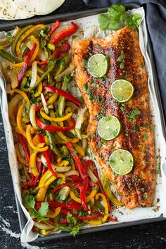 Quick and easy sheet pan salmon fajitas served with creamy avocado slices. Minimal prep, flavorful end result and simple clean up.