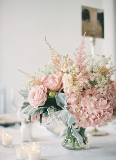 Centerpieces  candles hydrangeas Rose Blush babys breath white linen soft   Jen: I could swap out the roses with white dahlia cafe au laits?