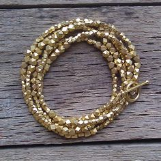 love this long, layered gold beads necklace ~ could be a pretty, simple project that could be really versatile