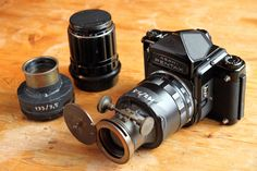 Pentax 67 with a Takumar 135mm lens and antique Petzval projection lenses mounted with foam core and gaffer tape to macro extension rings. What makes focusing possible on these is that the antique lenses have their original focus mechanisms.