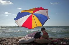 In this Monday, June 2014 photo, a Palestinian boy sits under an umbrella as he and others enjoy a summer day at the beach of Gaza City Fotojournalismus, Male Enhancement, Summer Days, Health And Wellness, Beach Mat, The Past, Outdoor Blanket, Around The Worlds, City