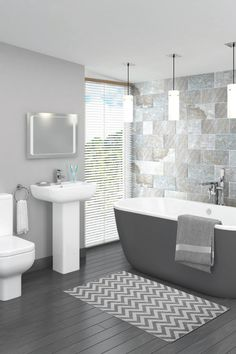 This modern bathroom suite includes a grey painted freestanding bath, full pedestal basin and close coupled toilet.