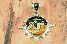 Native American Jewelry  This Pendant is a work of art! Beautiful Starry Night Design with a Shooting Star! Featuring Picture Jasper, and Black Jade inlaid in Sterling Silver Pendant. Beautiful Fire and Ice Lab Opal Moon. Designed by Navajo Artist Calvin Begay.